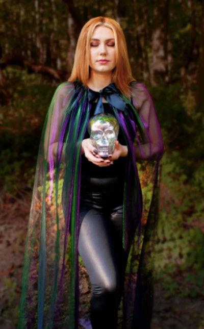 Girl wearing a wizard cape