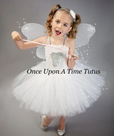 Girl dressed as the Tooth Fairy