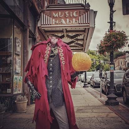 headless horseman halloween decoration holding pumpkin in Sleepy Hallow
