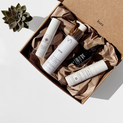 image of gift set with four clean beauty products from Kura Skin, together in cardboard box