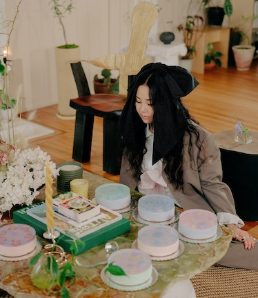 Lexie Park sits in front of her jelly cake creations.