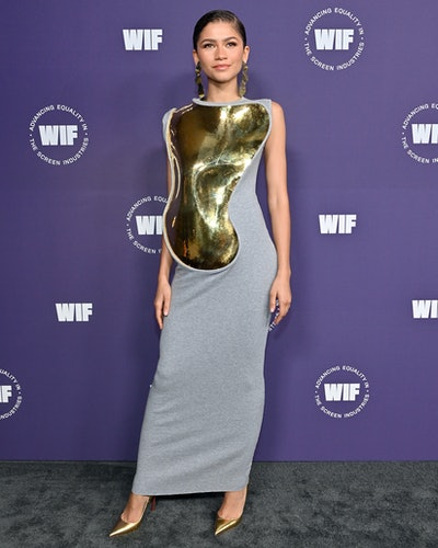Zendaya wearing Loewe metal plate dress.