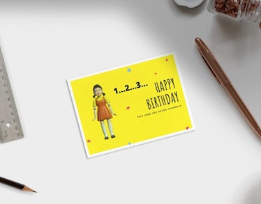 This robot doll card is one of many instant download 'Squid Game' birthday cards on Etsy.