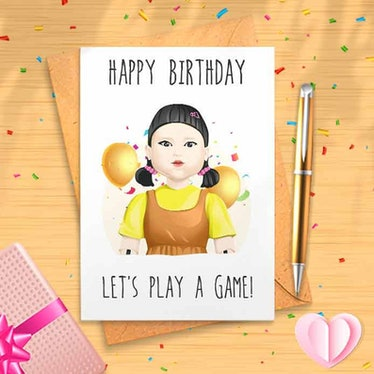 The doll from 'Squid Game' is on the front of some 'Squid Game' birthday cards on Etsy.