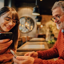 A dad and daughter look at finsta accounts together. What is a finsta? Here's how to explain finsta ...