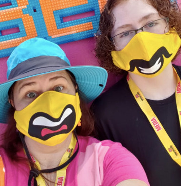 Two people wearing Lego face masks
