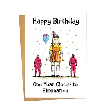 This doll and guard card is part of the many 'Squid Game' birthday cards on Etsy.