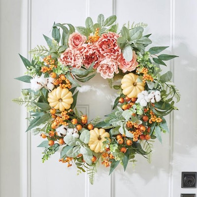 wreath with mini pumpkins, peonies, and eucalyptus