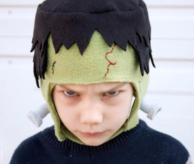 Kid wearing a Frankestien mask