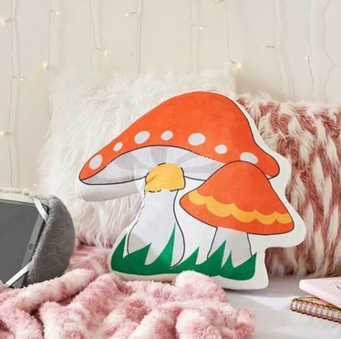 This mushroom throw pillow is part of Forever21's Home store launch collection.