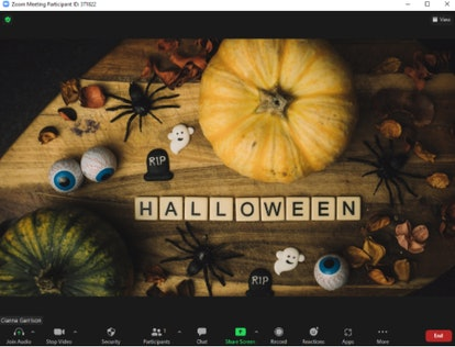These Halloween Zoom backgrounds include a festive table design.