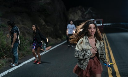 Ashley Moore as Riley searching for the body following the group's car accident in 'I Know What You ...