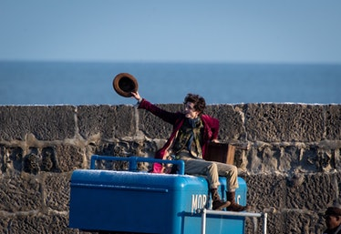 Timothée Chalamet is seen as Willy Wonka leaving the ship on the top of a van during filming for the...