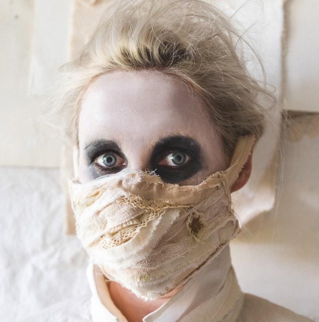 Woman wearing a mummy mask