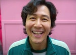 Gi-Hun in 'Squid Game' smiles for his picture like he would after receiving some 'Squid Game' birthd...