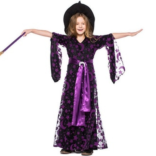 little girl in a purple witch dress from etsy