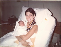 A young Elizabeth Warren and her baby daughter, Amelia, sitting in a hospital bed.