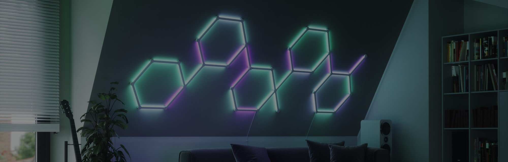 Nanoleaf Lines installed on a wall above a sofa.