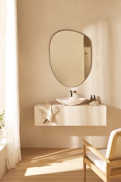 This irregular shaped mirror is sold by Zara's home decor line
