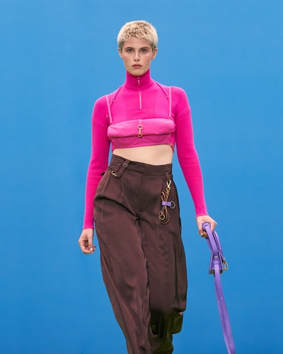 Model wears gorpcore-inspired cargo pants and a pink turtleneck during Jaquemus' Fall/Winter 2021 ru...