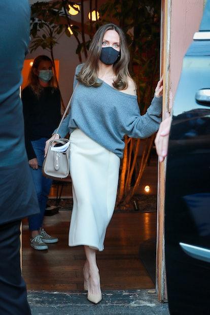 Angelina Jolie wearing a Loro Piana Sesia handbag.