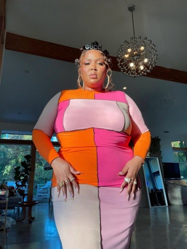 Lizzo wearing a colorful dress.