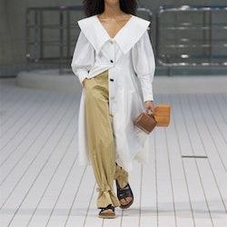 runway model carrying bags