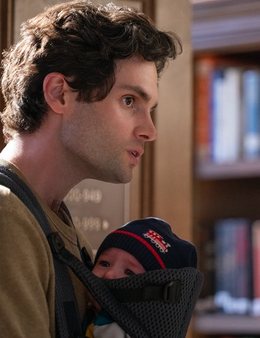 Penn Badgley holding a baby on his chest