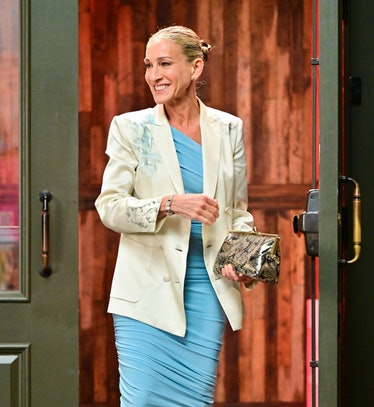 Carrie holding a clutch
