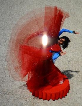 Xiaoyi Liu wears a Dior dress; Falke tights (worn as top); Supriya Lele leggings; Giorgio Armani bra...