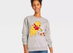 A woman wears some of Disney's 'Winnie the Pooh' 95th anniversary merch.