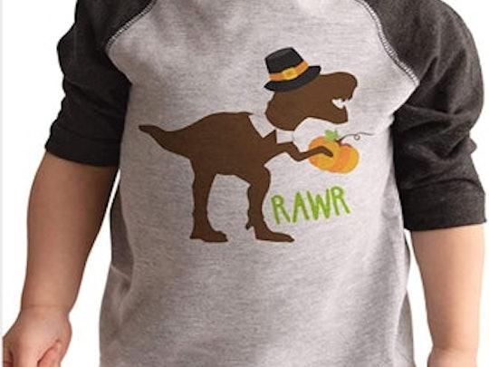 little boy in thanksgiving dinosaur t-shirt
