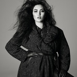 Model wears a plaid coat from Zara's Fall/Winter 2021 Studio collection.