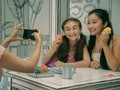 Anna Cathcart as Kitty and Lana Condor as Lara Jean in Netflix's 'To All the Boys'
