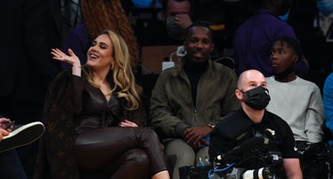 Singer Adele and Rich Paul attend a game between the Los Angeles Lakers and the Golden State Warrior...
