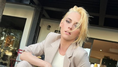 Kristen Stewart wearing Mango pantsuit and Converses.