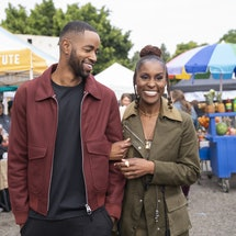 Issa and Lawrence walking through a street market in 'Insecure'