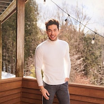 A solo photograph of Winter House cast member Andrea Denver, a white male model with brown hair wear...