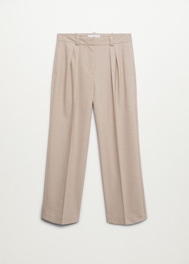 Beige pleated suit pants from Mango.
