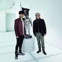 Hideo Kojima and Jean-François Rey posing together