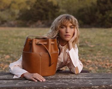 Arizona Muse with Anya Hindmarch's biodegradable leather bag.