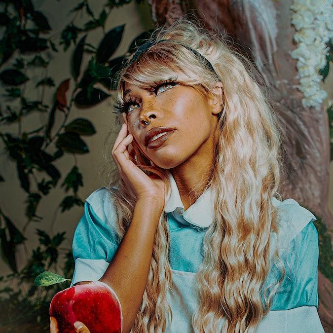 Black cosplayer Kiera Please dressed as Alice in Wonderland
