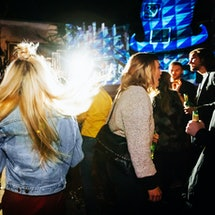 Woman out in nightclub.