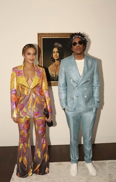 Beyoncé and Jay-Z wearing two-piece suits.