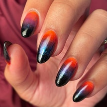From candy corn to ghosts to spider webs, these spooky manicures are here if you need design ideas f...