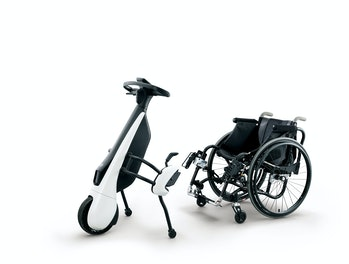 Toyota's new C+walk T mobility vehicle will be available in a configuration that attaches to a wheel...