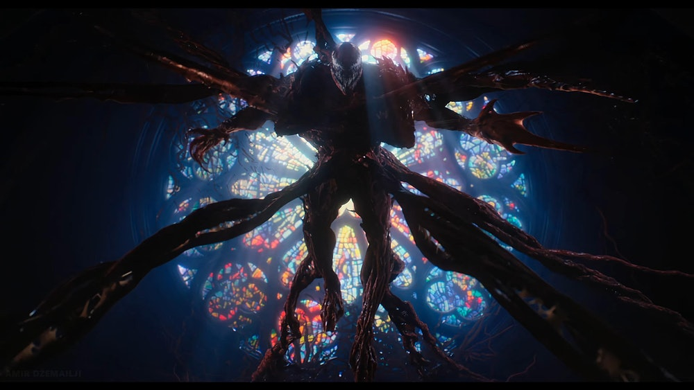 Carnage stretches out all of his limbs in front of a cathedral window