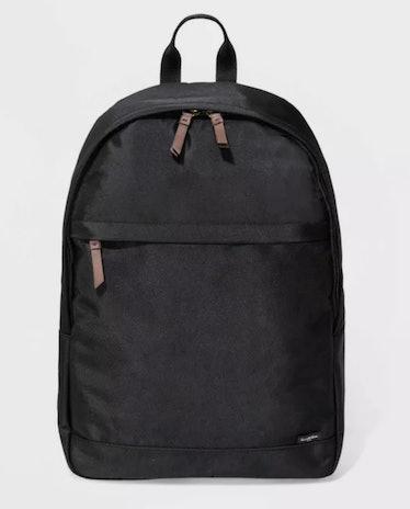 Joe Goldberg carries a black backpack on 'You.'