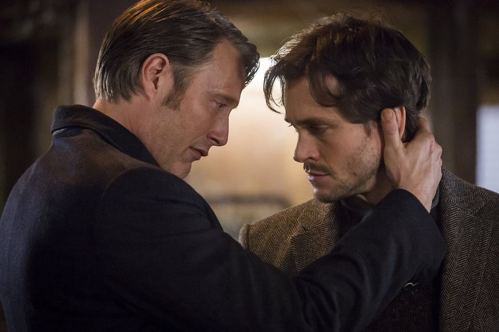 Hannibal has his hand on Will's neck