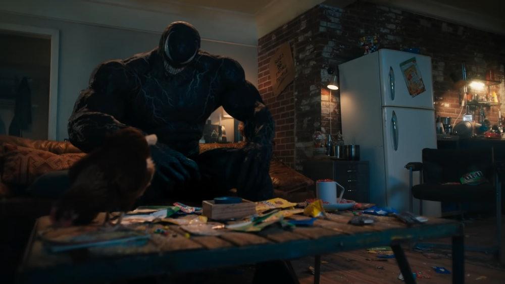 Venom and Eddie hang out in Eddie's apartment with Venom's pet chicken.